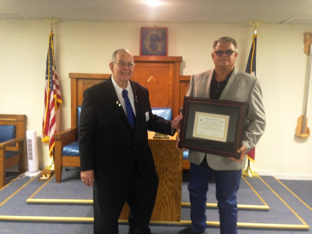 Brother Bob Lindley receiving this year's Golden Trowel Award at Wolfforth-Frenshp Lodge from DDGM at Large Glenn Fant. Also presenting on behalf of Masonic District 93-A was Charles Mire (not pictured)